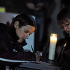 Lauren Daniels, left, and Sarah Kubley, write letters to the detained hikers.<br /> A vigil in support of three American hikers detained in Iran  was held at the Pearl Street courthouse lawn Sunday evening. Shane Bauer, Sarah Shourd and Josh Fattel were arrested July 31, 2009 as they strayed across an unmarked border during a  hiking trip in Iraqi Kurdistan.<br /> Cliff Grassmick / November 8, 2009