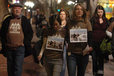 Natalie Senske, right, and Shannon Bauer, left center,  the sister of one of the detained hikers, pass out information about the situation on the Pearl Street Mall with other supporters. A vigil in support of three American hikers detained in Iran  was held at the Pearl Street courthouse lawn Sunday evening. Shane Bauer, Sarah Shourd and Josh Fattel were arrested July 31, 2009 as they strayed across an unmarked border during a  hiking trip in Iraqi Kurdistan. Cliff Grassmick / November 8, 2009