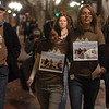 Natalie Senske, right, and Shannon Bauer, left center,  the sister of one of the detained hikers, pass out information about the situation on the Pearl Street Mall with other supporters.<br /> A vigil in support of three American hikers detained in Iran  was held at the Pearl Street courthouse lawn Sunday evening. Shane Bauer, Sarah Shourd and Josh Fattel were arrested July 31, 2009 as they strayed across an unmarked border during a  hiking trip in Iraqi Kurdistan.<br /> Cliff Grassmick / November 8, 2009