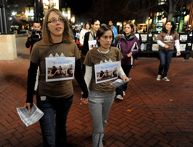 Natalie Senske, left, and Shannon Bauer, the sister of one of the detained hikers, pass out information about the situation on the Pearl Street Mall with other supporters. A vigil in support of three American hikers detained in Iran  was held at the Pearl Street courthouse lawn Sunday evening. Shane Bauer, Sarah Shourd and Josh Fattel were arrested July 31, 2009 as they strayed across an unmarked border during a  hiking trip in Iraqi Kurdistan. For more photos of the Vigil, go to www.dailycamera.com. Cliff Grassmick / November 8, 2009