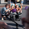 Record-Eagle/Keith King<br /> Jayme Kratkey, of Traverse City, gives ice cream to his daughter, Avery, 1, as his son, Cole, 4, sits near as they listen to music Friday, July 20, 2012 on Front Street during Friday Night Live.