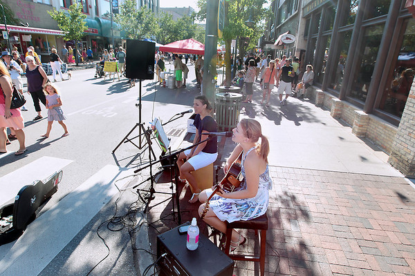 Record-Eagle/Keith King<br /> Britt Wagner, left, of Kalamazoo, and Hannah Rae Beale, of Frankfort, perform at the intersection of Cass Street and Union Street Friday, July 20, 2012 during Friday Night Live.