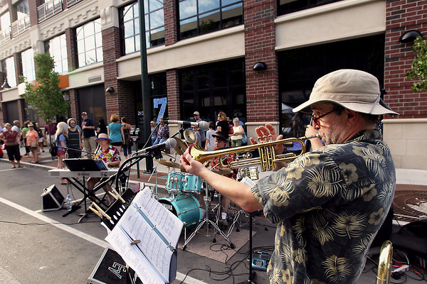 Record-Eagle/Keith King<br /> Steve Carey, of Interlochen, plays the trombone with the band, BoBossa, Friday, July 22, 2011 during Friday Night Live in downtown Traverse City.