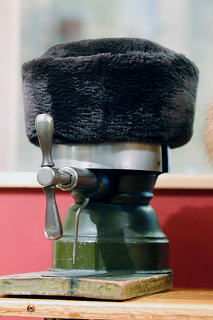 Record-Eagle/Jan-Michael Stump<br /> A dyed, sheared beaver hat sits on a hat stretcher from the 1920's that belonged to the grandmother of Fridrich Furs owner Michael Henke, a third generation furrier.