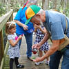 <b>Tom Poulson shows a caterpillar on a leaf to Ruth Pearson Smith and grandchildren and Sue Snyder</b> January 20, 2013 <i>- Kay Larche</i>