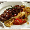 Char grilled sirloin with bacon sauce, roasted potato slices and fresh vegetables.