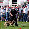 Anderson Police K-9 officer Gabe Bailey gives a K-9 demonstration with his dog Evi before the start of the Friends of the Poor Walk.