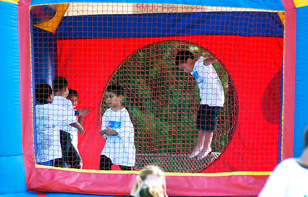 Kids were having fun in the bounce house and other activities surrounding the Friends of the Poor Walk.