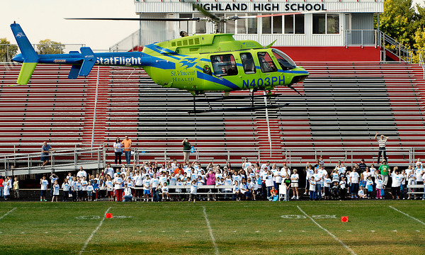 StatFlight medical helicopter takes off at the beginning of the Friends of the Poor Walk.