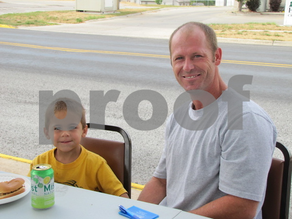 Mitch Alstott and his son, Tuffy attended the credit union's 50 year celebration.