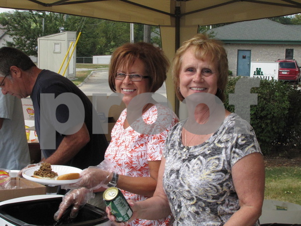 Judy Waddell and Norma Adson served lunch at the 50 year anniversary of the Frontier Community Credit Union.