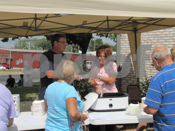Mike and Judy Waddell served lunch to attendees at the Frontier Community Credit Union's 50 year celebration.