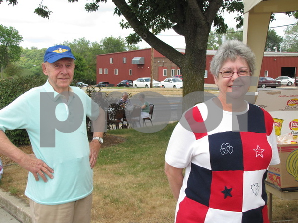 Del Loot and Sheila Eldredge wait in line for lunch at the Frontier Community Credit Union's 50 year celebration.