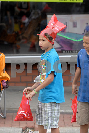 -Messenger photo by Hans Madsen<br /> <br /> Javontae Sankey, 11, of Algona, found a new use for his second candy collection bag Saturday morning while watching the annual Frontier Days Parade.