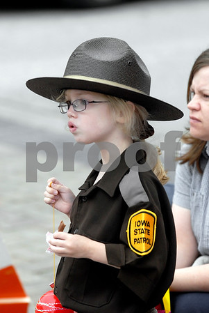 -Messenger photo by Hans Madsen<br /> <br /> Liberty Gardner, 5, got to not only ride in the Frontier Days Parade Saturday morning with her dad, State Trooper Paul Gardner, she also got to come back and watch the remainder in uniform.