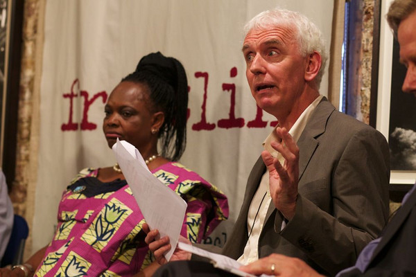 "Steve Crawshaw, international advocacy director Amnesty International and author of "" Small Acts of Resistance: How Courage, Tenacity, and Ingenuity Can Change the World"". Alice Ukoko in the background."
