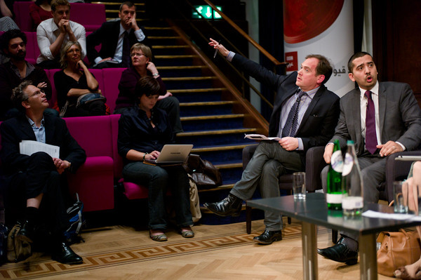 Mid-debate, Paddy O'Connell indicates where the next question will come from.
