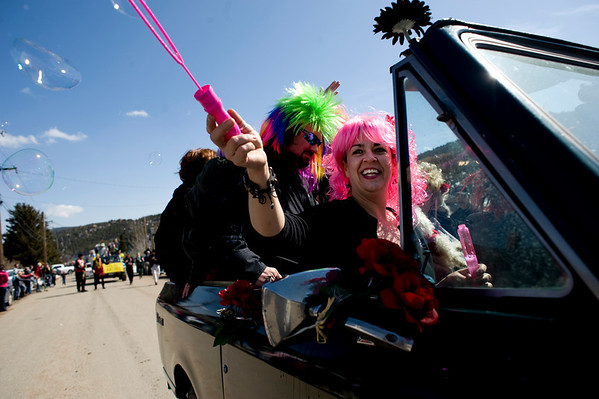 "Laura Boneham, right, visiting from Indianapolis, lets the wind blow bubbles as she rides through the parade during Frozen Dead Guy Days in Nederland, Saturday, March 6, 2010.  <br /> <br /> For a video of the event, please visit  <a href=""http://www.dailycamera.com"">http://www.dailycamera.com</a><br /> <br /> KASIA BROUSSALIAN"