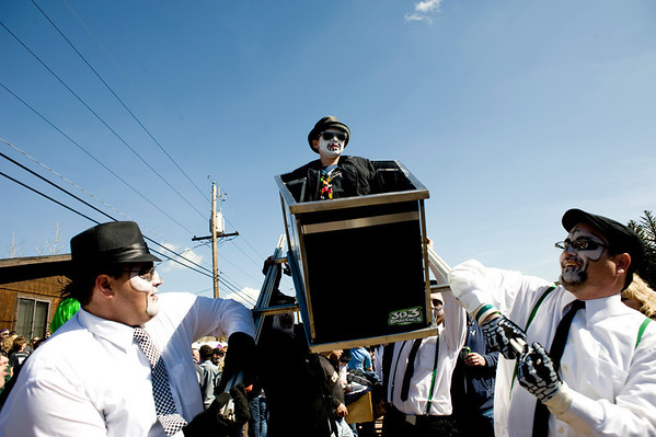 "Brenden McKinney, 9, sits in the coffin while his coffin race teammates Sam Svetlitskiy (left) and Sky Edge carry him during Frozen Dead Guy Days in Nederland, Saturday, March 6, 2010.  <br /> <br /> For a video of the event, please visit  <a href=""http://www.dailycamera.com"">http://www.dailycamera.com</a><br /> <br /> KASIA BROUSSALIAN"