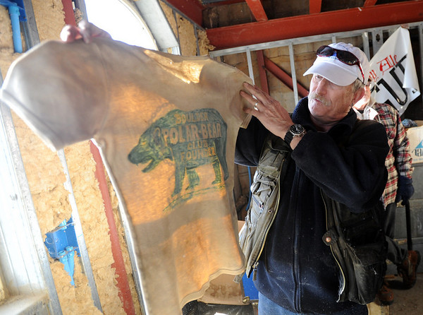 """Tour guide, Bo """"Ice Man"""" Schaffer, holds up Trygve's Polar Bear Club T-shirt. As part of the 10th annual Frozen Dead Guys Days, a tour of Trygve Bauge's house outside Nederland  was given, including his frozen grandfather, who is in a Tuff Shed.<br /> Cliff Grassmick/ March 4, 2011"""