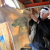 "Tour guide, Bo ""Ice Man"" Schaffer, holds up Trygve's Polar Bear Club T-shirt. As part of the 10th annual Frozen Dead Guys Days, a tour of Trygve Bauge's house outside Nederland  was given, including his frozen grandfather, who is in a Tuff Shed.<br /> Cliff Grassmick/ March 4, 2011"