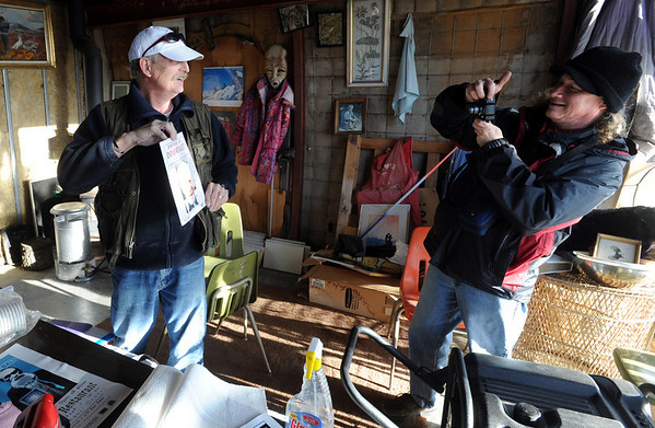 """Tour guide, Bo """"Ice Man"""" Schaffer, left, is photographed by Ed Kramer of Denver.<br /> As part of the 10th annual Frozen Dead Guys Days, a tour of Trygve Bauge's house outside Nederland  was given, including his frozen grandfather, who is in a Tuff Shed.<br /> Cliff Grassmick/ March 4, 2011"""