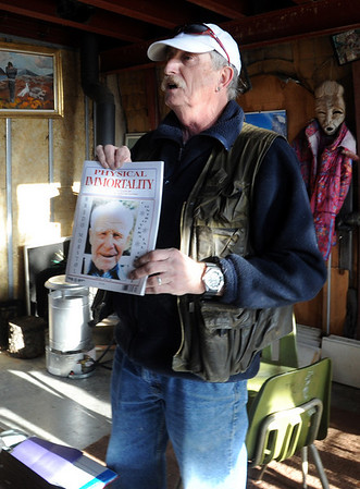 """Tour guide, Bo """"Ice Man"""" Schaffer, talks about how Bredo Morstoel made the cover of some national magazines.<br /> As part of the 10th annual Frozen Dead Guys Days, a tour of Trygve Bauge's house outside Nederland  was given, including his frozen grandfather, who is in a Tuff Shed. For more photos and a video of the tour, go to  <a href=""""http://www.dailycamera.com"""">http://www.dailycamera.com</a>.<br /> Cliff Grassmick/ March 4, 2011"""