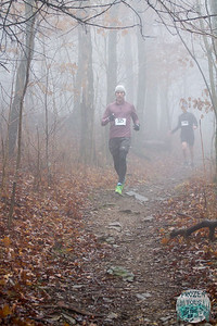 The fog and rain didn't stop adventurous runners from taking the trails on Kessler Mountain during Fayetteville's Frozen Toes 15k, Saturday.  Photos for this race have been paid for courtesy of Fayetteville Parks and Recreation.  Race Participants are granted permission to make any and all prints and to post online as wanted for personal use only. This authorization pertains to and only to the images that begin with the numbers Frozen Toes - Erin 0001.