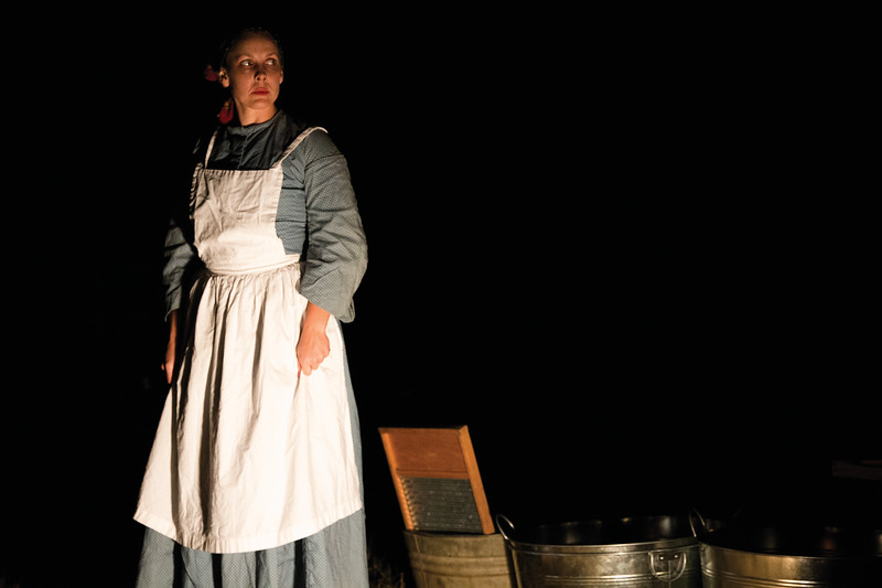 Matthew Gaston | The Sheridan Press<br>Misty Stoll as Minnie the laundress, paints a bleak image of life as a civilian woman living at the Fort Phil Kearny in the late 1800's; a life filled with death, disease, hardship and more husbands than you can shake a stick at Saturday, Oct. 20, 2018.