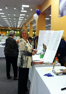 Marypaz, Library volunteer (and Friends Board member) looked very pleased with the tally of silent auction sales.