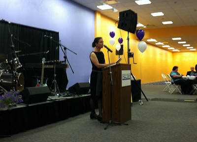 Stephanie Moore, Event Chair, announced the opening of the Live Auction.