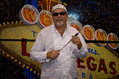Photo of painter Robert Holton in front of his iconic Las Vegas sign painting which premiered at the G2E Show in Las Vegas and was raffled off to winner Wes Claggert. Find out more about Robert at www.DrizzleArt.com