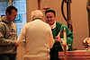 Fr. Thi Pham receives the offertory gifts from Frater Greg Schill and Fr. Frank Clancy.