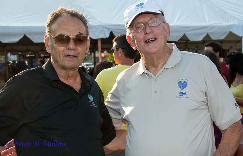 Bill Petit senior in his Petit Family Foundation attire meets a friend.