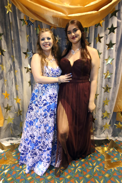 . Greater Lowell Tech prom. Sydney Moulton of Dracut, left, and Alexis Newson of Lowell.  (SUN/Julia Malakie)