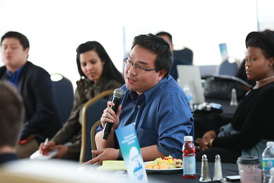Student Nguyen Le asks question during panel