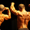 Record-Eagle/Garret Leiva<br /> First-place finisher Chad Krusniak, right, performs a back double biceps pose next to Joaquin Alfonseca, second place, in the Tall Men class at the 29th annual Grand Traverse Bodybuilding and Figure Championship, presented by Fit For You Health Club Saturday at the Leelanau Sands Showroom.