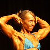 Record-Eagle/Garret Leiva<br /> Second-place finisher Ali Ferrigan flexes her biceps as she competes in the Short Woman class at the 29th annual Grand Traverse Bodybuilding and Figure Championship, presented by Fit For You Health Club Saturday at the Leelanau Sands Showroom.