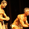 Record-Eagle/Garret Leiva<br /> First-place finisher Doug Vogler grimaces as he flexes for the judges along with second-place finisher Mike Mascott in the Master Men class at the 29th annual Grand Traverse Bodybuilding and Figure Championship, presented by Fit For You Health Club Saturday at the Leelanau Sands Showroom.