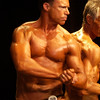 Record-Eagle/Garret Leiva<br /> Doug Vogler, right, and Michael Johns flex for the judges in the Master Men class at the 29th annual Grand Traverse Bodybuilding and Figure Championship, presented by Fit For You Health Club Saturday at the Leelanau Sands Showroom.