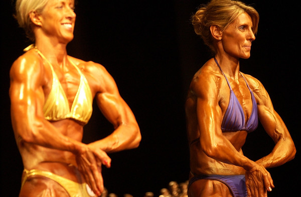 Record-Eagle/Garret Leiva<br /> Second-place finisher Kim Harvey, right, and Kim Purdy, first place, compete in the Tall Women class at the 29th annual Grand Traverse Bodybuilding and Figure Championship, presented by Fit For You Health Club Saturday at the Leelanau Sands Showroom.