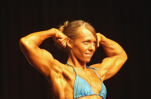 Record-Eagle/Garret Leiva<br /> Second-place finisher Ali Ferrigan flexes her biceps as she competes in the Short Woman class at the 29th annual Grand Traverse Bodybuilding and Figure Championship presented by Fit For You Health Club Saturday at the Leelanau Sands Showroom.