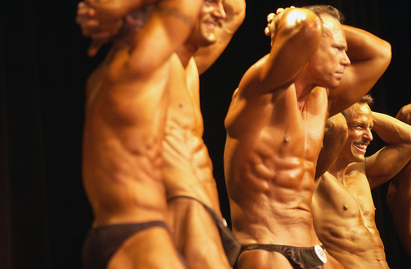 Record-Eagle/Garret Leiva<br /> Competitors in the Short Men class tighten their ab muscles at the 29th annual Grand Traverse Bodybuilding and Figure Championship presented by Fit For You Health Club Saturday at the Leelanau Sands Showroom.