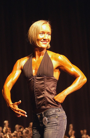 Record-Eagle/Garret Leiva<br /> Second-place finisher Tricia Felski competes in the Figure Open class at the 29th annual Grand Traverse Bodybuilding and Figure Championship presented by Fit For You Health Club Saturday at the Leelanau Sands Showroom.