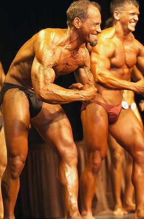 Record-Eagle/Garret Leiva<br /> Dave Fehrenbach, left, gives his best muscle pose alongside Paul Bliss in the Tall Men class at the 29th annual Grand Traverse Bodybuilding and Figure Championship presented by Fit For You Health Club Saturday at the Leelanau Sands Showroom.