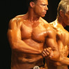 Record-Eagle/Garret Leiva<br /> Doug Vogler, right, and Michael Johns flex for the judges in the Master Men class at the 29th annual Grand Traverse Bodybuilding and Figure Championship presented by Fit For You Health Club Saturday at the Leelanau Sands Showroom.