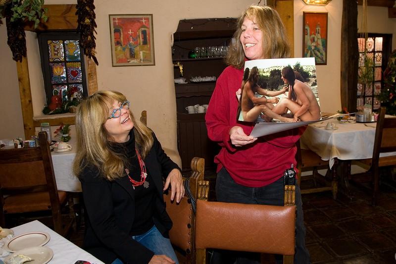 Robin & Louise looking at '60's era photos taken by Doug Magnus.