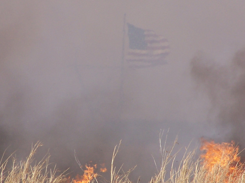 Grass fire with flag outside Oklahoma City