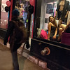 Kayla Rice/Reformer<br /> Models pose for passerby in the windows of Life's Little Luxuries on Elliot St. in Brattleboro during gallery walk on Friday evening.
