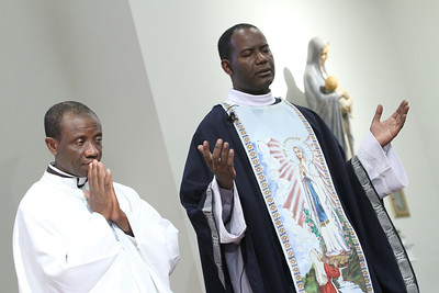 Father Guyma Noel, right, pastor of Christ Our Hope Church, was the main celebrant and homilist for the Sang Marie Mass. He was joined on the altar by Father Anthony Mbanefo, pastor of Holy Redeemer Church, McRae.  (Page 27, September 15, 2011 issue)